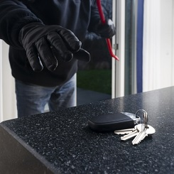 Burglar taking car key